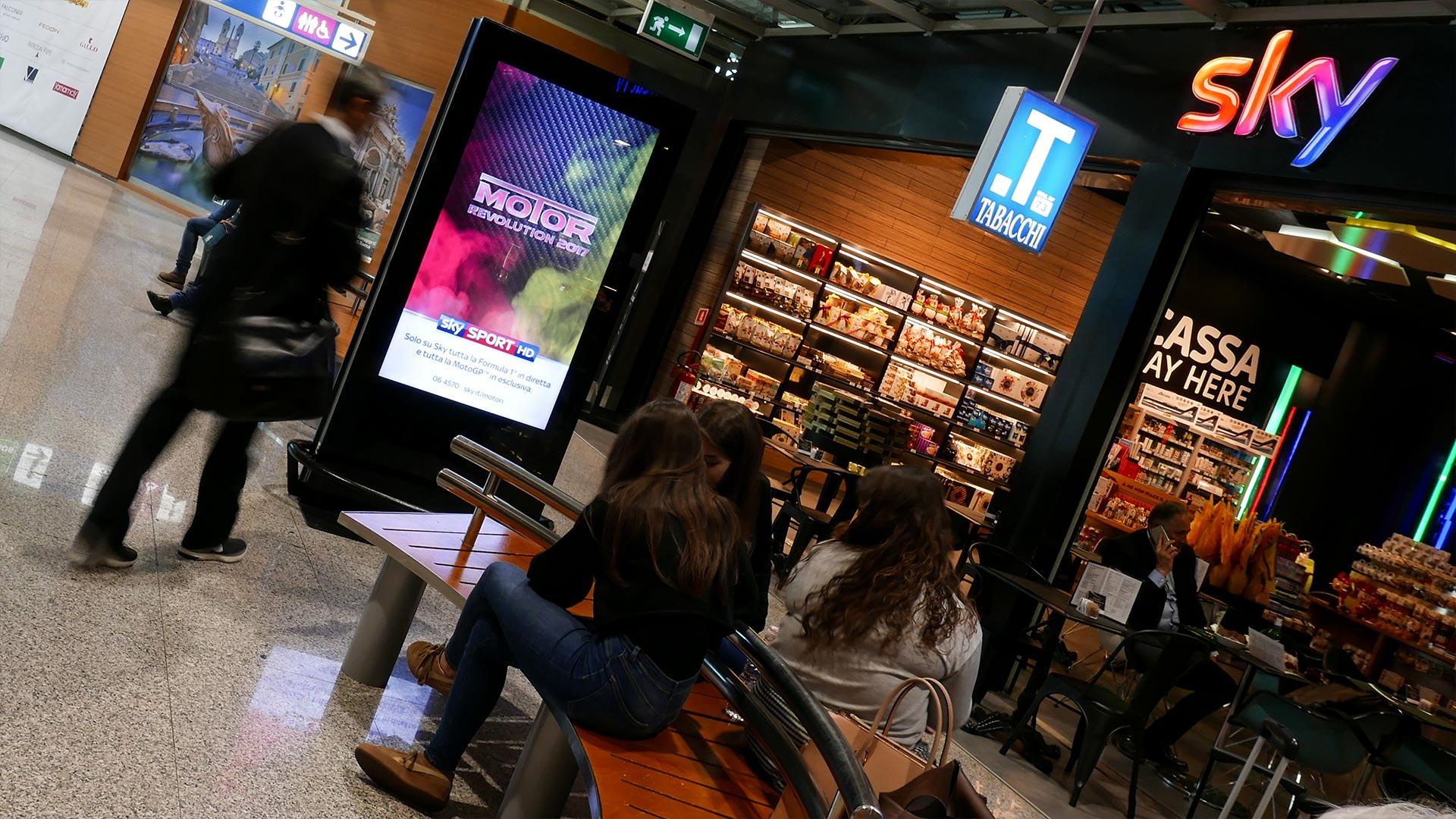 Digital totem and Sky streaming in airport